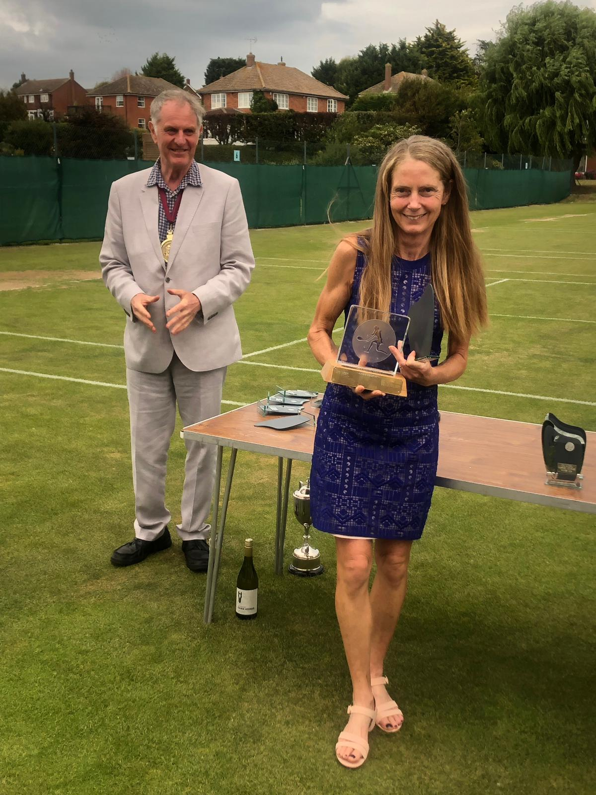 Lynn received flowers for organising and running the tournament draw and then winning the 40 and Over Ladies Singles trophy